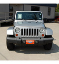 jeep wrangler unlimited 2007 silver suv sahara gasoline 6 cylinders rear wheel drive 6 speed manual 77706