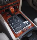 jeep grand cherokee 2006 black suv overland gasoline 8 cylinders 4 wheel drive automatic 33021