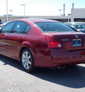 nissan maxima 2004 dk  red sedan 3 5 sl gasoline 6 cylinders front wheel drive shiftable automatic 77074