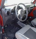 jeep wrangler 2009 orange suv x 6 cylinders 6 speed manual 98371