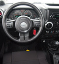 jeep wrangler unlimited 2012 green suv rubicon gasoline 6 cylinders 4 wheel drive 6 speed manual 76011