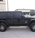 jeep wrangler unlimited 2010 black suv sahara gasoline 6 cylinders 4 wheel drive automatic with overdrive 76011