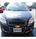 chevrolet aveo5 2009 black hatchback lt gasoline 4 cylinders front wheel drive automatic with overdrive 77581