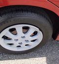 kia rio 2005 orange sedan 4 cylinders 5 speed manual 99336