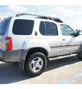 nissan xterra 2004 silver suv gasoline 6 cylinders rear wheel drive automatic 77034