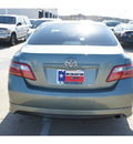 toyota camry 2007 lt  green sedan se gasoline 4 cylinders front wheel drive automatic 77034