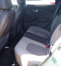 hyundai tucson 2013 green gls gasoline 4 cylinders front wheel drive autostick 77065