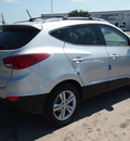 hyundai tucson 2013 silver gls gasoline 4 cylinders front wheel drive autostick 77065
