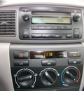 toyota corolla 2005 green sedan 4 cylinders automatic with overdrive 13502