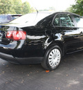volkswagen jetta 2009 black sedan s gasoline 5 cylinders front wheel drive 5 speed manual 27616