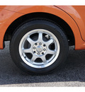 chevrolet aveo 2007 orange sedan lt 4 cylinders automatic 77074
