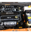 chevrolet aveo 2007 orange sedan lt 4 cylinders automatic 77074
