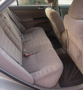 toyota camry 2005 tan sedan standard gasoline 4 cylinders front wheel drive automatic 76049