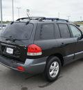hyundai santa fe 2006 black suv gls gasoline 6 cylinders front wheel drive shiftable automatic 76087
