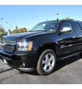 chevrolet tahoe 2012 black suv ltz flex fuel 8 cylinders 2 wheel drive automatic 77581