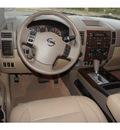 nissan titan 2011 white sl flex fuel 8 cylinders 2 wheel drive automatic 76543