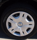 nissan versa 2010 black hatchback 1 8 s gasoline 4 cylinders front wheel drive automatic with overdrive 76018