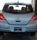 nissan versa 2011 lt  blue hatchback 1 8 s gasoline 4 cylinders front wheel drive automatic with overdrive 77477