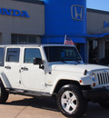 jeep wrangler unlimited 2010 white suv sahara gasoline 6 cylinders 4 wheel drive automatic 77065