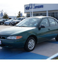 ford escort 1999 dk  green sedan se 4 cylinders automatic 77094