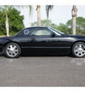 ford thunderbird 2002 black deluxe gasoline 8 cylinders rear wheel drive automatic 78550