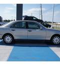 mercedes benz e class 1999 gold sedan e320 gasoline 6 cylinders rear wheel drive automatic 77094