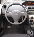 toyota yaris 2009 red hatchback gasoline 4 cylinders front wheel drive automatic 76018