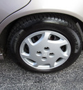 toyota corolla 1998 gold sedan le gasoline 4 cylinders front wheel drive 5 speed manual 45840