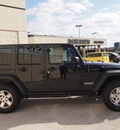 jeep wrangler unlimited 2012 black suv rubicon gasoline 6 cylinders 4 wheel drive automatic 76011