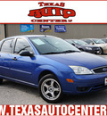 ford focus 2005 dk  blue sedan zx4 ses gasoline 4 cylinders front wheel drive 5 speed manual 78666