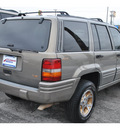jeep grand cherokee 1997 brown suv limited gasoline 8 cylinders 4 wheel drive automatic 78217