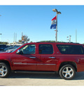 chevrolet suburban 2011 red suv ltz 1500 flex fuel 8 cylinders 2 wheel drive automatic 77090