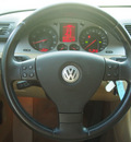 volkswagen passat 2009 black sedan komfort gasoline 4 cylinders front wheel drive automatic 77074