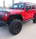 jeep wrangler unlimited 2011 red suv sport gasoline 6 cylinders 4 wheel drive automatic 77539