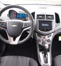 chevrolet sonic 2013 orange sedan lt gasoline 4 cylinders front wheel drive not specified 77090