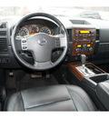 nissan titan 2011 white sl flex fuel 8 cylinders 4 wheel drive automatic 76502