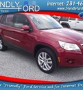 volkswagen tiguan 2010 red suv gasoline 4 cylinders front wheel drive automatic with overdrive 77532