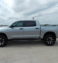 toyota tundra 2011 silver sr5 flex fuel 8 cylinders 4 wheel drive automatic with overdrive 77469