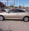 toyota camry solara 2004 beige coupe se gasoline 4 cylinders front wheel drive automatic with overdrive 77020