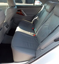 toyota camry 2010 white sedan xle v6 6 cylinders shiftable automatic 77074