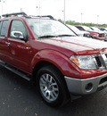 nissan frontier 2010 red le gasoline 6 cylinders 4 wheel drive automatic 34474