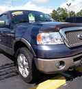 ford f 150 2006 dk  blue lariat gasoline 8 cylinders 4 wheel drive automatic with overdrive 32401