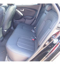 hyundai tucson 2013 black limited gasoline 4 cylinders front wheel drive automatic 77074