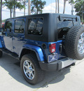 jeep wrangler unlimited 2010 blue suv sahara 6 cylinders automatic 77339
