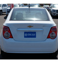 chevrolet sonic 2013 off white sedan lt gasoline 4 cylinders front wheel drive automatic 76801