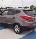 hyundai tucson 2012 brown gls gasoline 4 cylinders all whee drive automatic 77094