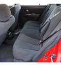 nissan versa 2012 red hatchback special edition gasoline 4 cylinders front wheel drive automatic 78552