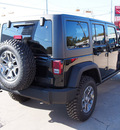 jeep wrangler unlimited 2014 black suv rubicon gasoline 6 cylinders 4 wheel drive automatic with overdrive 77864
