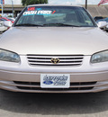 toyota camry 1998 gold sedan xle v6 6 cylinders automatic 77521