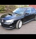 subaru impreza 2006 black sedan wrx sti gasoline 4 cylinders all whee drive 6 speed manual 97211